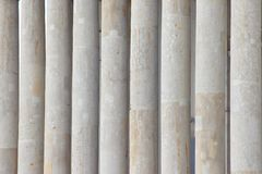 The columns of marble, the background of the columns. the structure of the stone monolith. smudges from old age royalty free stock images