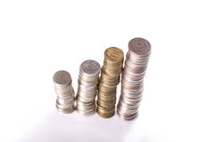 Columns from metallic currency Stock Images