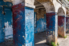 Columns of old abandoned building in industrial urban area with. Peeling paint and plaster.  Exterior Royalty Free Stock Images