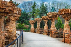 Columns in Park Guell designed by Antoni Gaudi in Barcelona, Spain. Columns among the trees made of stone in Park Guell designed by Antoni Gaudi in Barcelona stock photography