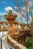 Columns in Park Guell designed by Antoni Gaudi in Barcelona, Spain. Columns among the trees made of stone in Park Guell designed by Antoni Gaudi in Barcelona stock image