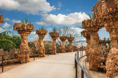 Columns in Park Guell designed by Antoni Gaudi in Barcelona, Spain. Columns among the trees made of stone in Park Guell designed by Antoni Gaudi in Barcelona royalty free stock photo