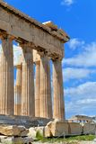Columns of the Parthenon with blue sky. Columns of the Parthenon in ruins, in a sunny day. The background is blue sky with white clouds royalty free stock photography