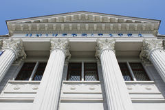 Columns and pediment university architecture. Big university building with tall columns and big triangular pediment at the top made in roman style royalty free stock images