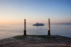 Columns Pier and Tagus River at Sunrise in Lisbon Stock Images