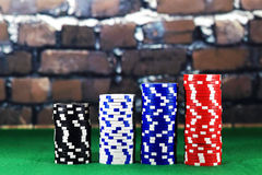 Columns of poker chips on green poker table stock photography