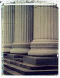 Columns - Polaroid image transfer. Bases of a row of marble columns. Architectural details. Polaroid image transfer on a watercolor paper with a rough texture Stock Image
