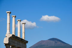 Columns at pompei. Columns at the ancient roman city of pompei with vesuvius in the background stock photography