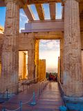 Columns of Propylaea entrance gateway of Acropolis, Athens, Greece overlooking the sunset and the city royalty free stock photography