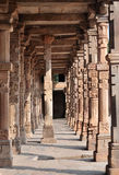 Columns in Qutub Courtyard 2, Delhi, India. The Qutub complex included a mosque whose structure included covered spaces supported by stone columns Royalty Free Stock Photography