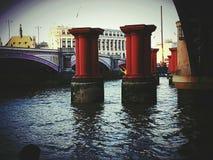 Columns redcolumns water river city centre London construction architecture. Thames river UK Britain British English London UK estate Royalty Free Stock Images