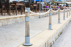 Columns that restrict the movement of vehicles and Parking, bars for limiting the movement, limiters or blocker.  Stock Photography