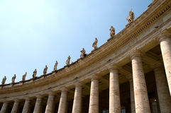 Columns at Saint Peters Square. Columns and statues at Saint Peters Square in Vatican Royalty Free Stock Photos