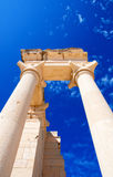 Columns of The Sanctuary of Apollo Hylates. Opposite blue sky - main religious centres of ancient Cyprus and one of the most popular tourist place Stock Photography