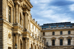 Columns and sculptures that adorn the facade of the Louvre in Pa Royalty Free Stock Photography