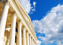 Columns and sky. Vintage columns and blue cloudy sky Stock Images