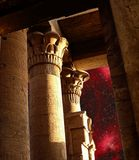 Columns of the Sobek Temple in Kom-Ombo and Eagle Nebula (Elemen. Photo-montage of the Sobek Temple columns in Kom-Ombo and Eagle Nebula (Elements of this image Royalty Free Stock Photography