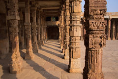 Columns with stone carving in courtyard of Quwwat-Ul-Islam mosqu Royalty Free Stock Image