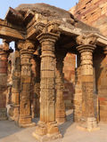 Columns with stone carving in courtyard of Quwwat-Ul-Islam mosqu Royalty Free Stock Photo