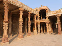 Columns with stone carving in courtyard of Quwwat-Ul-Islam mosqu Stock Images