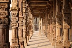 Columns with stone carving in courtyard of Quwwat-Ul-Islam mosque, Qutab Minar complex, Delhi. India royalty free stock image