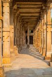 Columns with stone carving in courtyard of Quwwat-Ul-Islam mosque, Qutub Minar complex, Delhi, India Royalty Free Stock Image