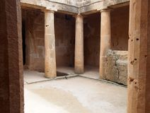 Columns in an underground tomb in paphos cyprus stock images