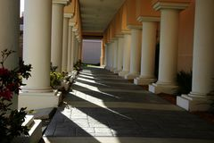 Columns in sunshine and shadows stock image