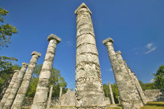 Columns surrounding grassy courtyard for ballgames at Chichen Itza, Mayan Ruins in the Yucatan Peninsula, Mexico Royalty Free Stock Photos