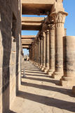 Columns symmetry. Egyptian ancient columns constructed with amazing symmetry and craft we can see perfect distance from each column to the other Stock Image