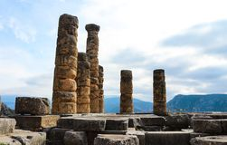 Columns from Temple of Apollo at ancient Delpi high in the moutains of Greece where the Oracles used to prophecy. Columns from the Temple of Apollo at ancient Royalty Free Stock Photos