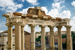 Columns of the temple of Saturn in Rome Stock Images