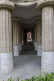 Columns under nature square. Line of columns under nature square at Hypostyle Room in Park Güell Barcelona stock image