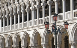 Columns in Venice. At Doge Palace with typical street lantern pole Royalty Free Stock Image