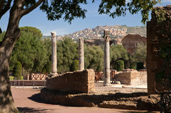 Columns and view of tivoli city from Villa Adriana Stock Photography