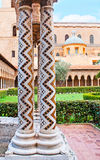 The columns with zigzag pattern. The white stone columns in garden of Monreale Cathedral decorated with zigzag inlay, consisting of small mosaic stars, Sicily royalty free stock photo
