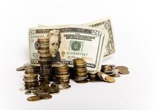 Coluna da nota de banco e das moedas fotos de stock