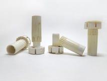 Colunas ajustáveis dos pés do plástico para a mobília Fotos de Stock