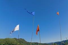 Colurful Buddhist Prayer flags flying high Stock Photo