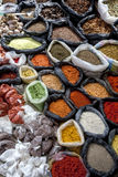 A colurful selection of spices, herbs and nuts for sale at a market stall in the Indian market in Otavolo in Ecuador. Stock Photography