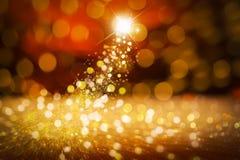 Comète de réveillon de Noël, particules, fond rouge, scintillement Photo stock