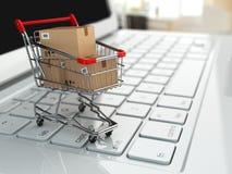 Comércio eletrônico. Carrinho de compras com as caixas de cartão no portátil. ilustração do vetor