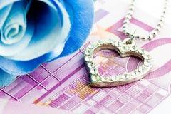 Amor da compra do dinheiro Fotos de Stock Royalty Free