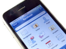 com-facebookiphone Arkivfoton
