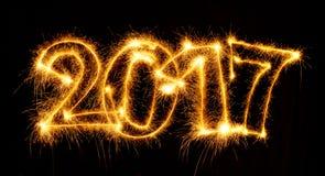 2017 com os chuveirinhos no fundo preto Imagens de Stock Royalty Free