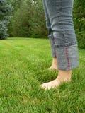 Com os pés descalços no verão Imagens de Stock