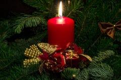 com uma vela para o Natal Imagem de Stock Royalty Free