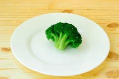 Coma brócolis Imagens de Stock