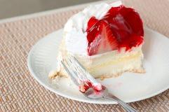 Coma la torta Imagen de archivo libre de regalías