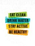Coma limpio Agua de la bebida Active de la estancia Sea sano Plantilla creativa inspiradora de la cita de la motivación Bandera d Foto de archivo